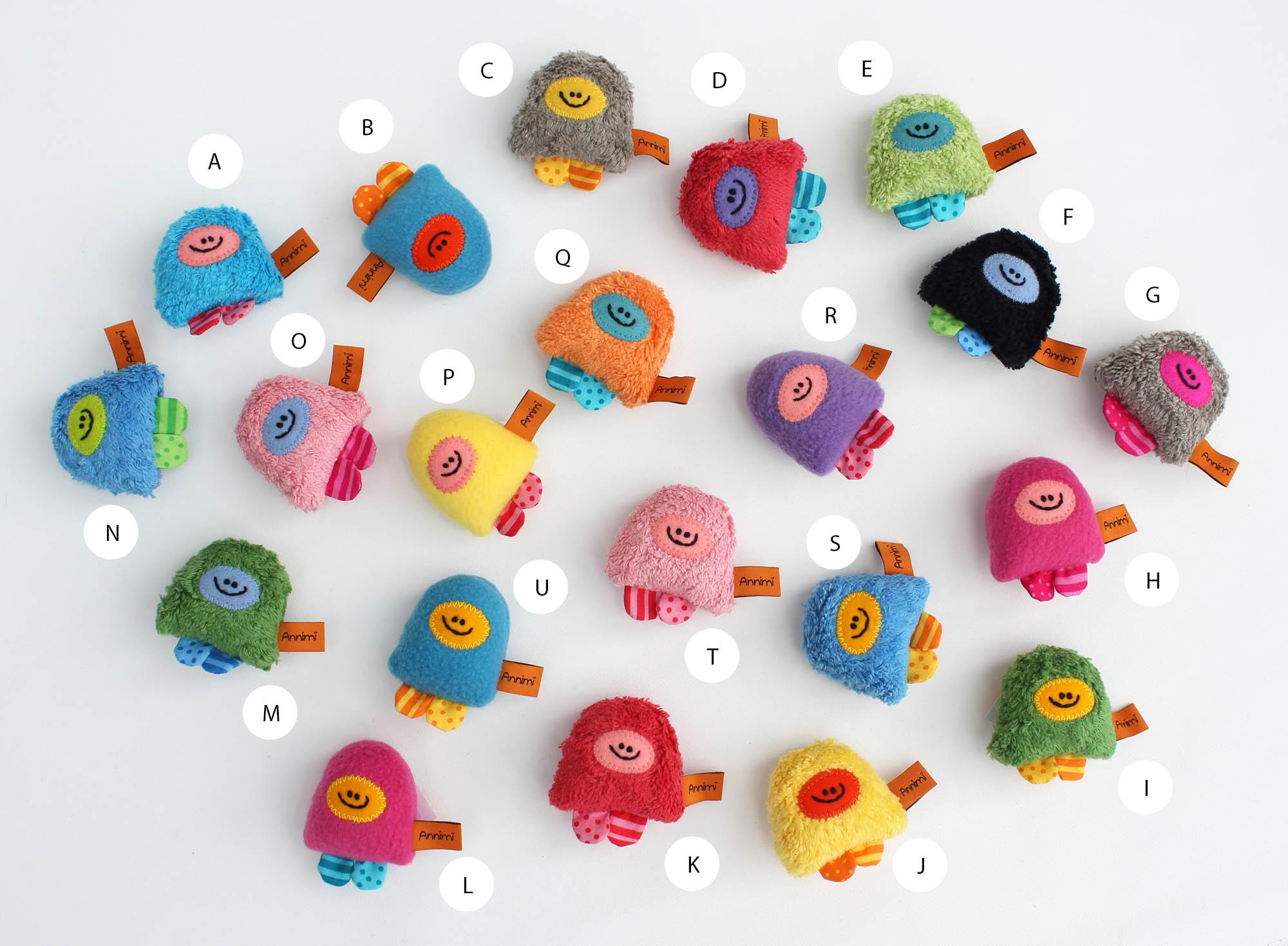 Taschenmonster-Gruppenfoto mit Buchstaben